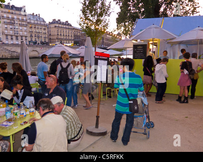 Paris, France, People Enjoying Annual Beach Event in City, Paris Plages, French Restaurant on Quay, River Seine - Stock Photo
