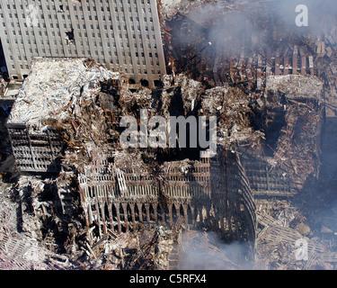 Aerial view of smoking ruins of ground zero, the World Trade Center following the 911 terrorist attacks - Stock Photo