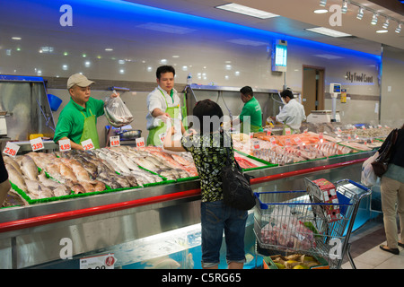 Shoppers at the seafood counter in the new Sky Foods supermarket in the Sky View Mall in Flushing neighborhood of - Stock Photo