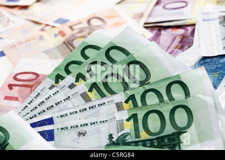 Various Euro bank notes, 100 Euro notes in foreground - Stock Photo
