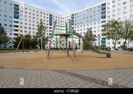 Empty playground, Plattenbau, pre-fabricated concrete buildings, social housing, residential estate, Jena, Thuringia, - Stock Photo