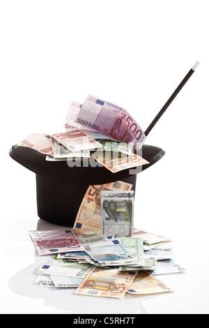 Different Euro bank notes, Top hat and magic wand - Stock Photo