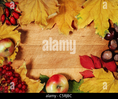 Still life with autumn leaves over wooden background - Stock Photo