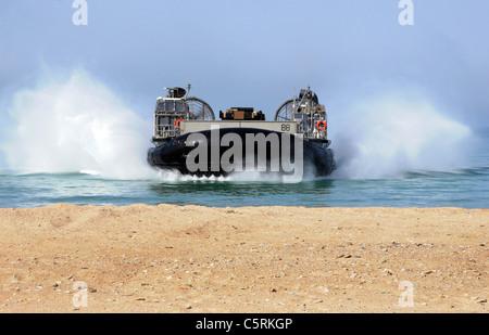 amphibious vehicle landing on beach - Stock Photo