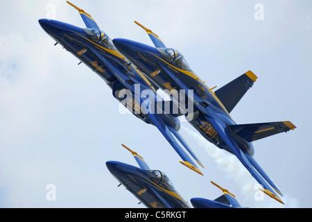 "The U.S. Navy flight demonstration squadron, the Blue Angels, perform the ""Diamond 360"" maneuver - Stock Photo"