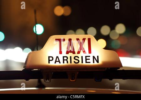 Paris taxi by the Arc de Triomphe - Stock Photo