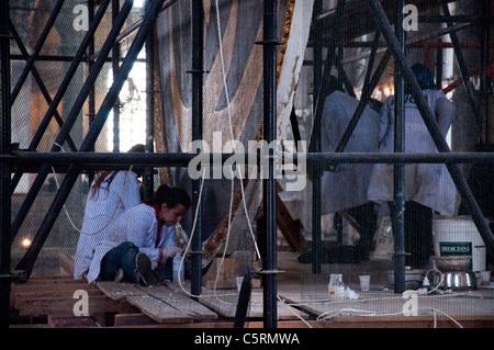 Resoration of Islamic signs, Ayasofya (Hagia Sophia) cathedral and mosque, Istanbul, Turkey - Stock Photo