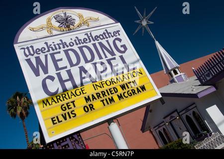 'Scottish' wedding chapel with Elvis and Tim McGraw in Las Vegas, Nevada, USA - Stock Photo
