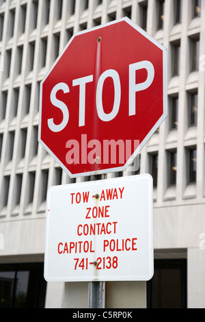 stop sign and tow away zone capitol police Nashville Tennessee USA - Stock Photo