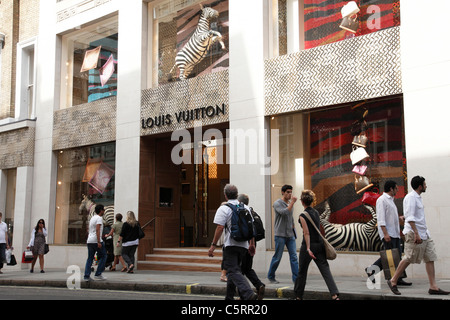 louis vuitton shop store window display of shoes and handbags on al stock photo royalty free. Black Bedroom Furniture Sets. Home Design Ideas
