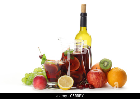 Refreshing sangria (punch) with fruits on white background - Stock Photo