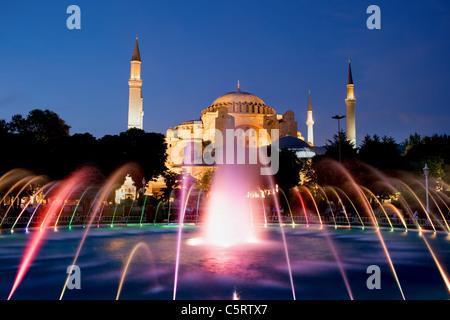 The Hagia Sophia Byzantine architecture and fountain illuminated at dusk, famous historic landmark in Istanbul, - Stock Photo