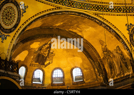 Blessed Virgin Mary with baby Jesus and Guardian Angel Byzantine art on the Hagia Sophia apse in Istanbul, Turkey - Stock Photo