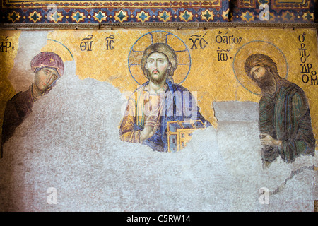 Deesis Mosaic of Jesus Christ (known as Christ Pantocrator) flanked by the Virgin Mary and John the Baptist in the - Stock Photo