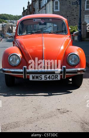 1977 Model Orange Volkswagen Beetle Motor Car - Stock Photo