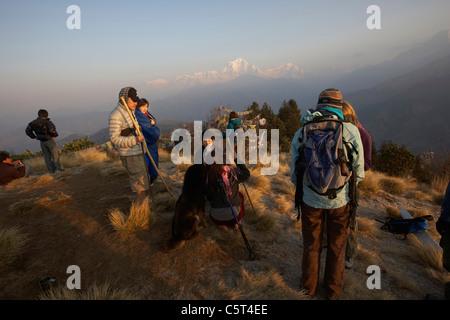 Tourist watching the sunrise on Dhaulagiri mountain from Poon Hill, Annapurna circuit, Nepal, Asia - Stock Photo