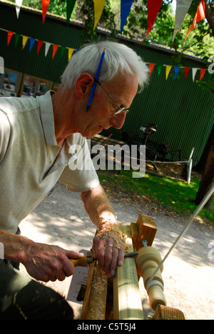 Man demonstrating how to make a spinning top at Rustic Sunday, an annual event celebrating traditional rural ways - Stock Photo
