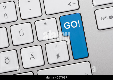 Close up of computer keys with go text on blue key - Stock Photo