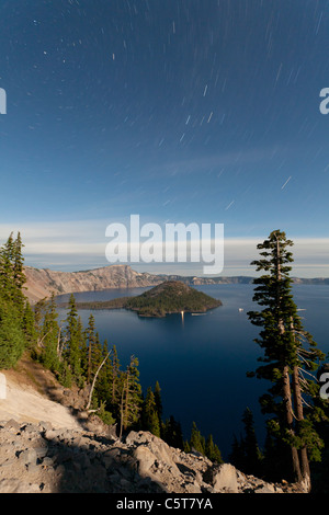 Crater Lake and Wizard Island at night with star trails Oregon USA - Stock Photo