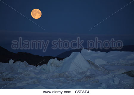 West Greenland, Ilulissat, Iceberg with full moon - Stock Photo