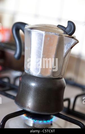 moka coffee pot on gass stove - Stock Photo