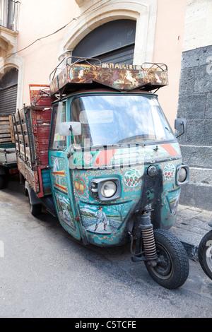 Tradionally decorated Piaggio Ape mini van in Catania Sicily - Stock Photo