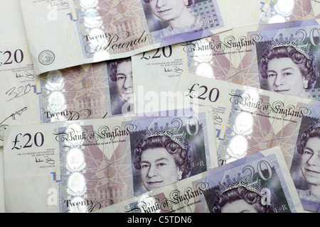 A Background Image Of Multiple British Twenty Pound Notes - Stock Photo