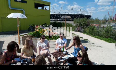 A group of young people sitting at outside restaurant at the View Tube 2012 Olympic Stadium East London England - Stock Photo