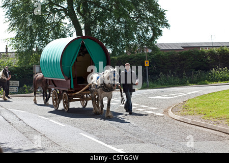 Horse drawn Gypsy Caravan at the Annual Horse Fair in Appleby in Westmoreland. - Stock Photo