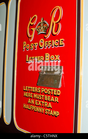 Post Office letter box on the side of an old railway sorting carriage - Stock Photo