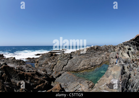 Spain, Canary Islands, Fuerteventura, Aguas Verdes, Rockpool coast in playa del valle - Stock Photo