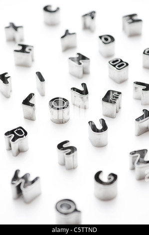 I Love U and alphabet letters / small pastry cutters on bright white background - Stock Photo