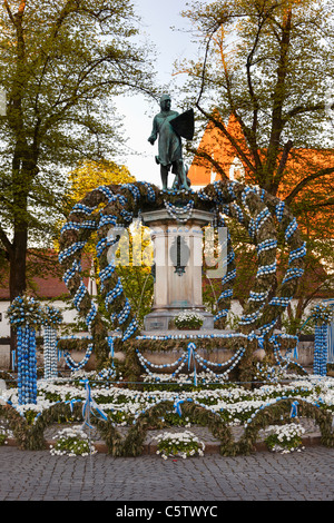 Germany, Bavaria, Upper Bavaria, Ingolstadt, Paradeplatz, View of fountain and statue decorated with easter eggs - Stock Photo