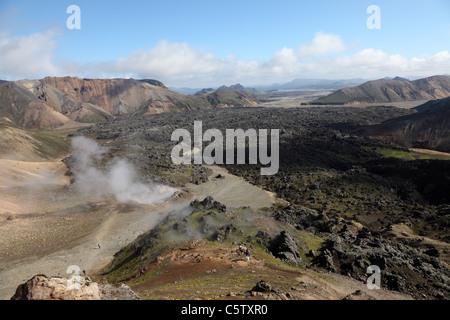 Old Lava Flow with Steam Rising from Fumeroles on the Laugavegur Hiking Trail Near Landmannalaugar Fjallabak Area - Stock Photo