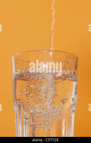 Water being poured into glass, close up - Stock Photo