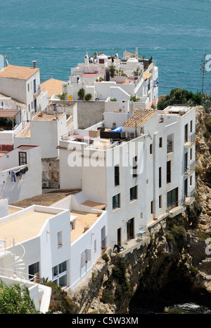 Housing and apartments built on cliffs at Eivissa in Ibiza a Spanish island in the Mediterranean - Stock Photo