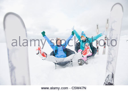 Italy, South Tyrol, Seiseralm, Couple relaxing in snow - Stock Photo
