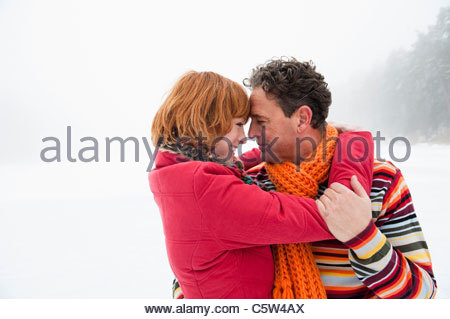Italy, South Tyrol, Seiseralm, Couple embracing, smiling, head to head - Stock Photo