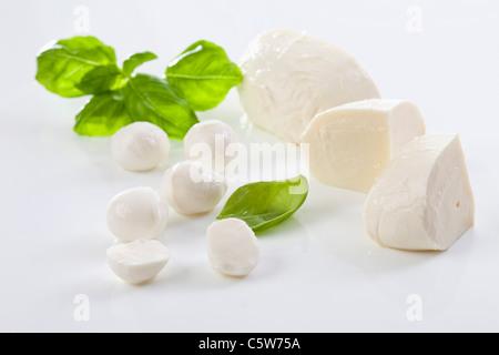 Mozzarella cheese and basil leaves - Stock Photo