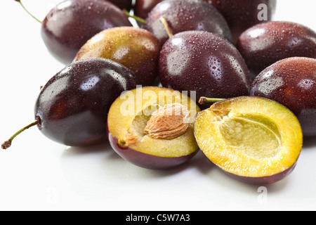 Entire and sliced plums - Stock Photo