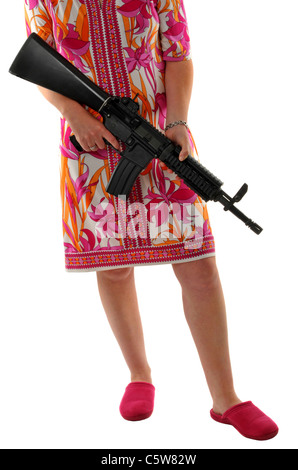 Woman with a gun wearing slippers - Stock Photo