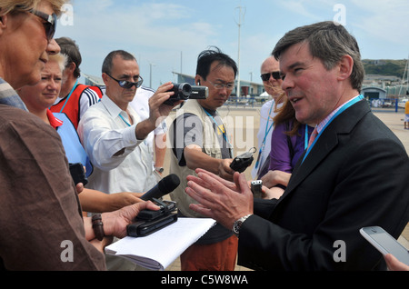 UK, Sports Minister Hugh Robertson visiting the Olympic sailing test event at the Weymouth and Portland National - Stock Photo