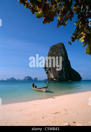 Asia, Thailand, Boat on beach, rock in background - Stock Photo
