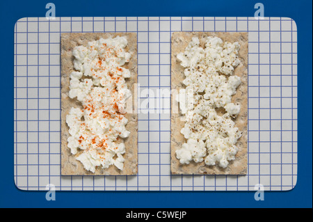 Crispbread with soft cheese, elevated view - Stock Photo
