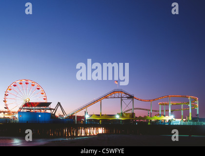 USA, California, Los Angeles, View of amusement park on the beach at evening - Stock Photo