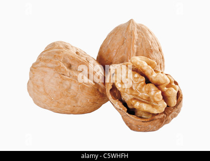 Whole and peeled walnuts against white background, close up - Stock Photo