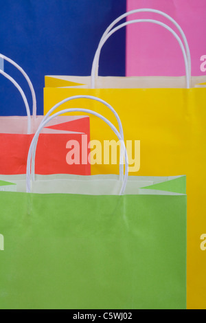 Multicoloured paper shopping bags, full frame, close-up - Stock Photo