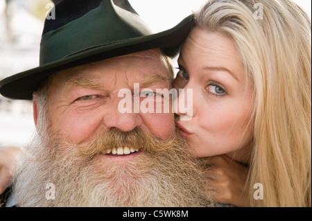 Germany, Bavaria, Upper Bavaria, Senior man and young woman, smiling, portrait, close-up - Stock Photo