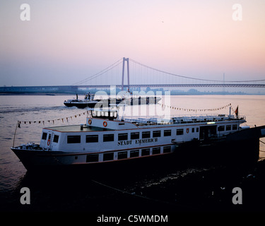Ausflugsschiff und Frachtschiff auf dem Rhein vor der Emmericher Haengebruecke, Emmerich, Niederrhein, Nordrhein - Stock Photo