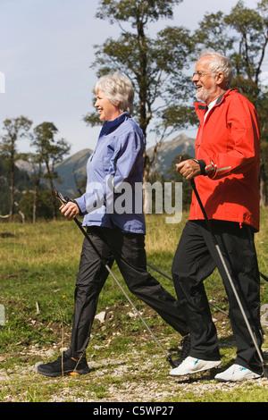 Austria, Karwendel, Ahornboden, Senior couple nordic walking - Stock Photo